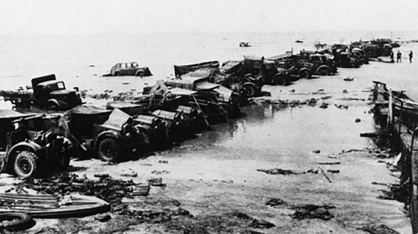 Vehicles moved onto the beaches by the Royal Engineers to create piers