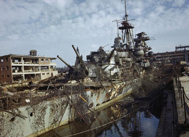 T Force were the first Allied troops to enter Kiel harbour. The damaged German cruiser ADMIRAL HIPPER was in dry dock and the ADMIRAL SCHEER was capsized nearby.