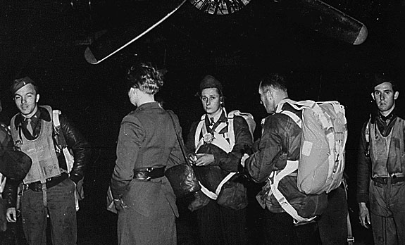 Jedburghs in front of B-24 just before night takeoff. Area T, Harrington Airdrome, England, circa 1944.
